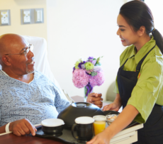 Serving food to elder patient