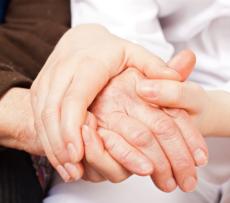 Holding hands of elder